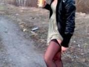 Orgiastic brunette wife Dasha showing her booty upskirt outdoors
